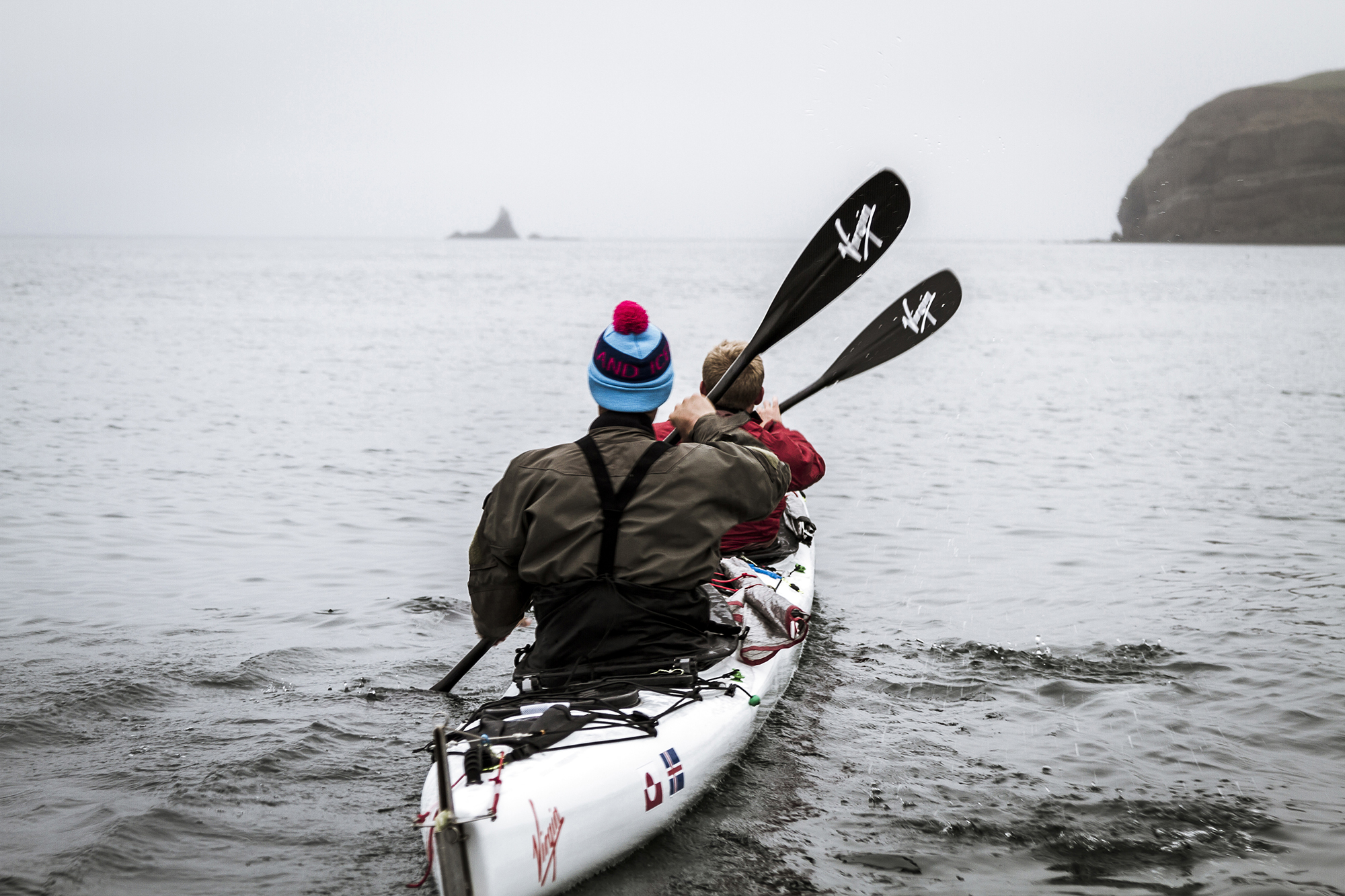 Olly Hicks head out in his carbon fibre kayak with companion George Bullard