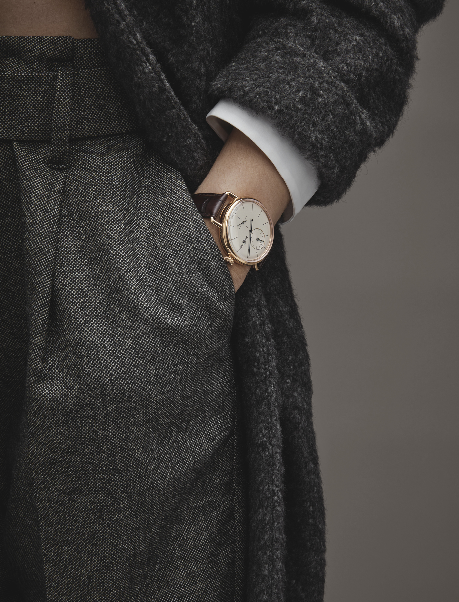 Grey wool trousers, £880, white shirt, £730, grey coat, £3,970, all BRUNELLO CUCINELLI; WW1 Regulateur rose gold watch, £14,000, BELL & ROSS