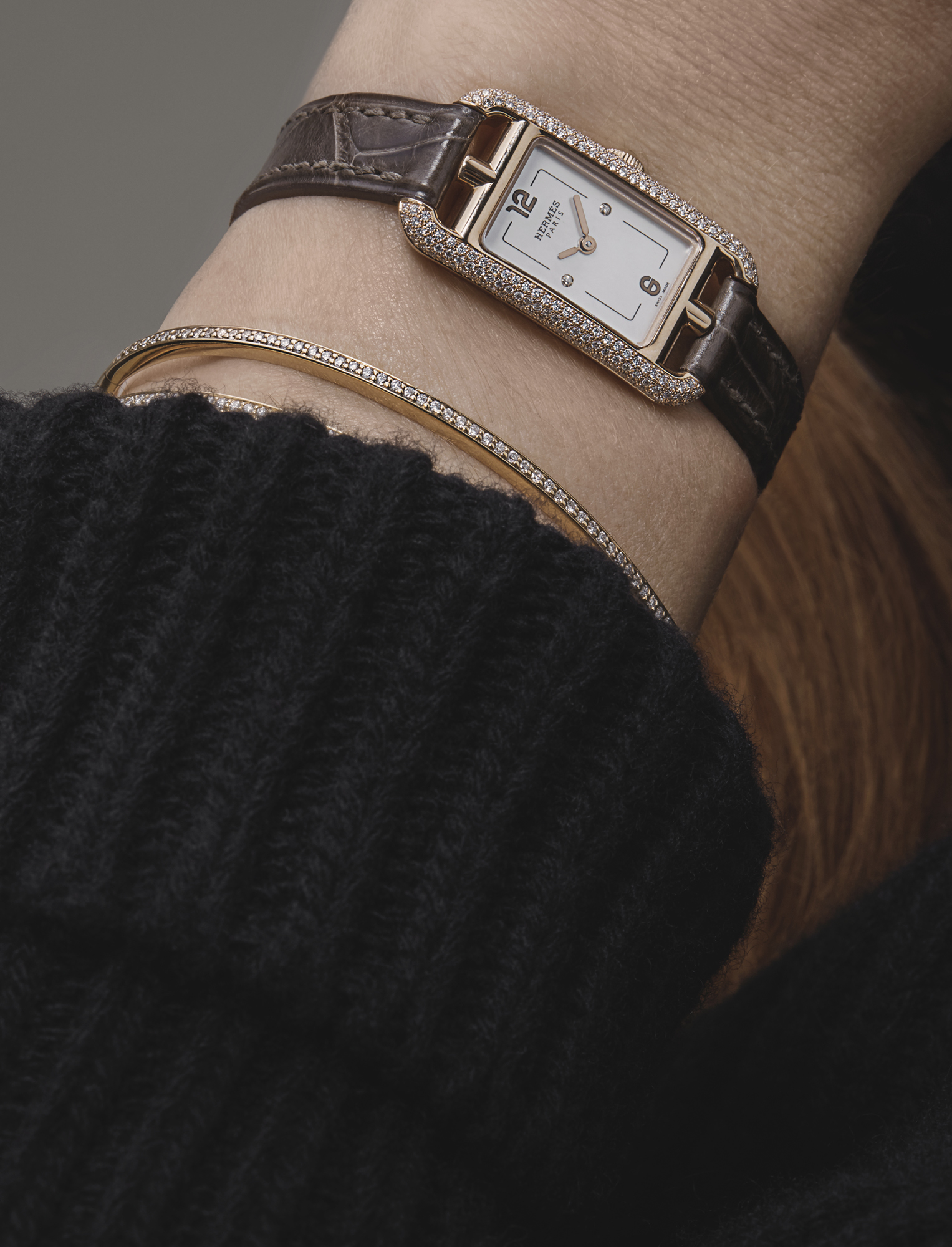Black rib knit sweater dress with cowl neck, £395, DAKS; Nantucket TPM watch, £10,000, HERMÈS; violetta yellow gold and diamond full pave bangle, £4,000, MAPPIN & WEBB