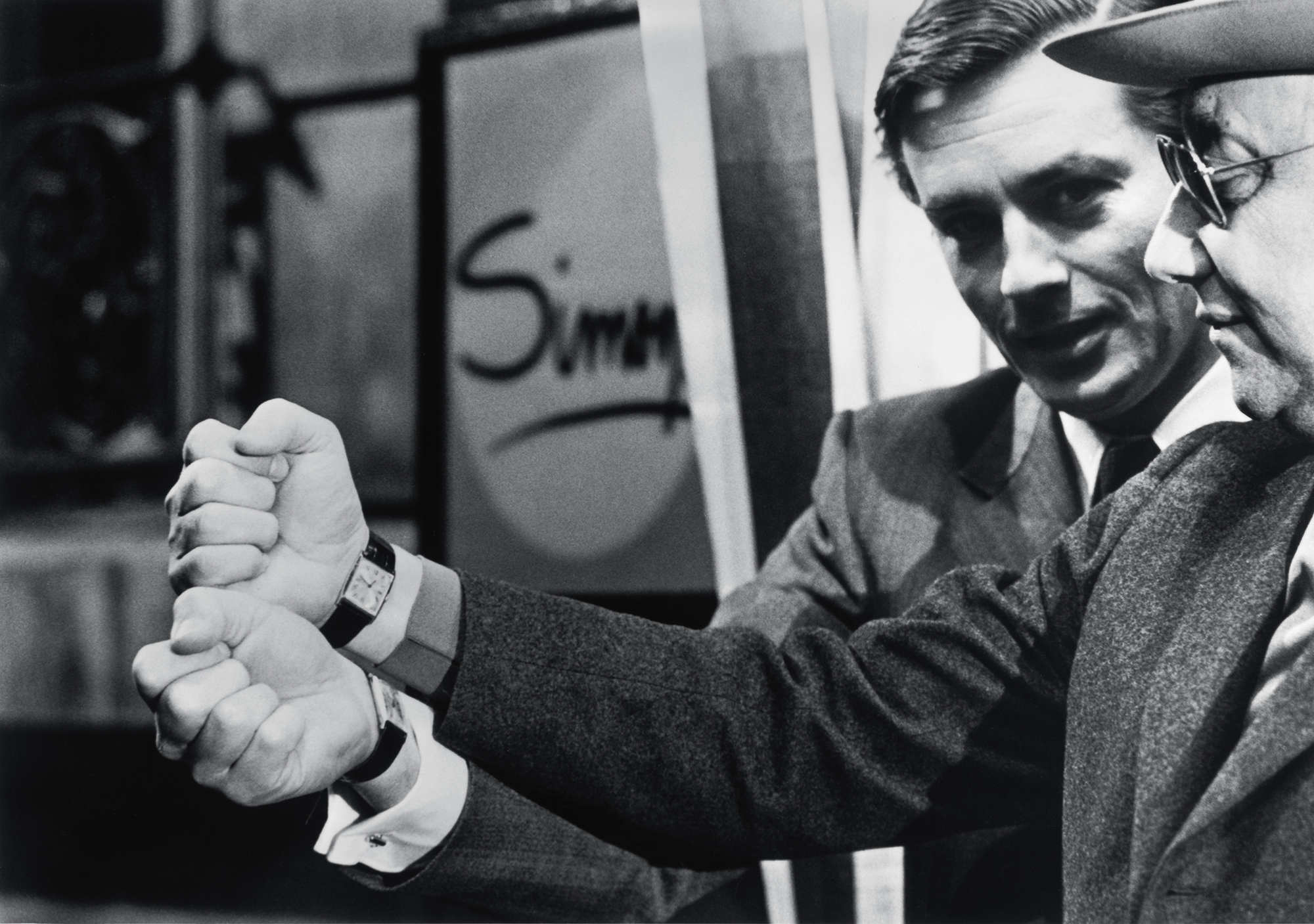 Alain Delon and Jean-Pierre Melville, both wearing the Cartier Tank watch that turns 100 this year