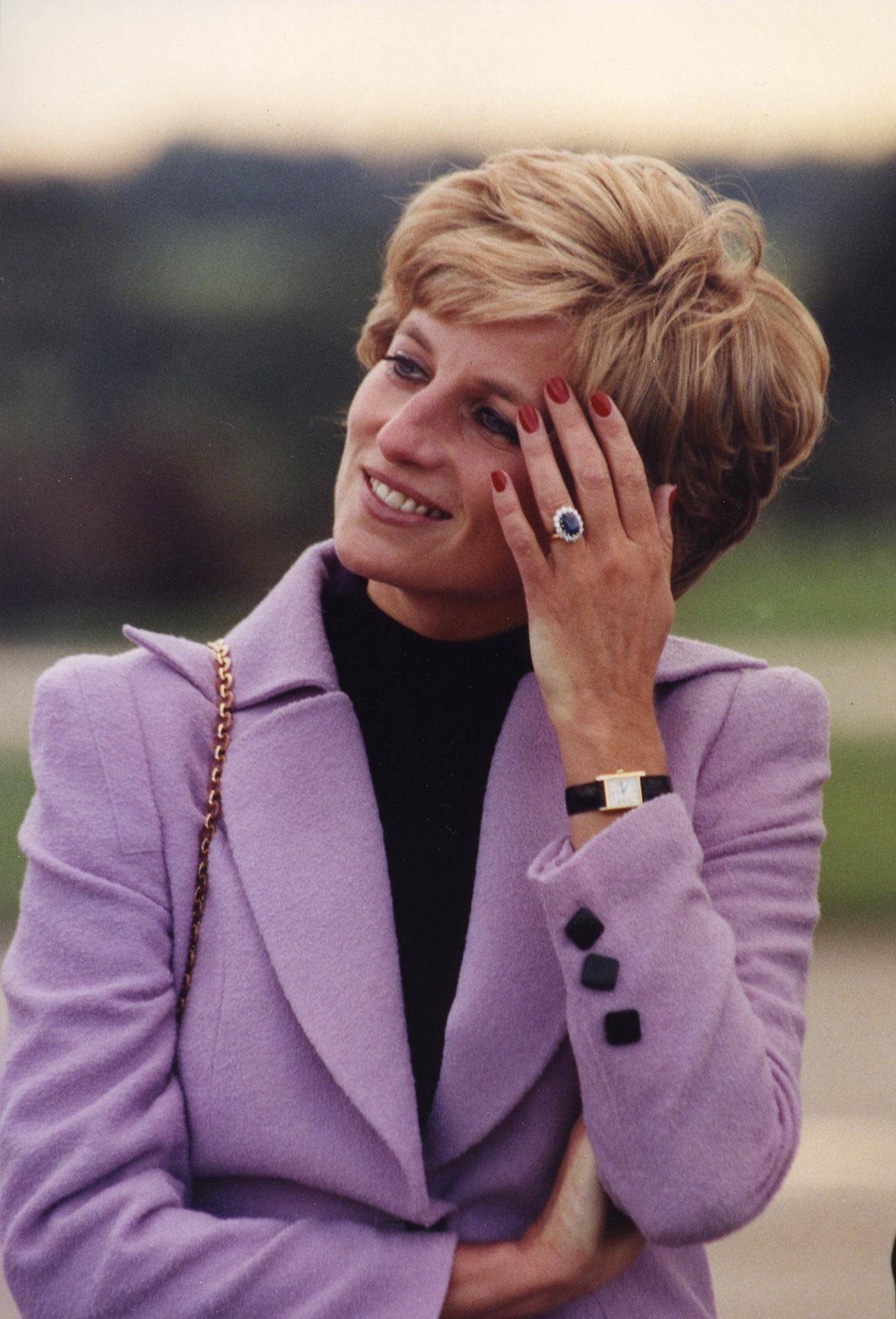 Lady Diana wearing her Cartier Tank watch