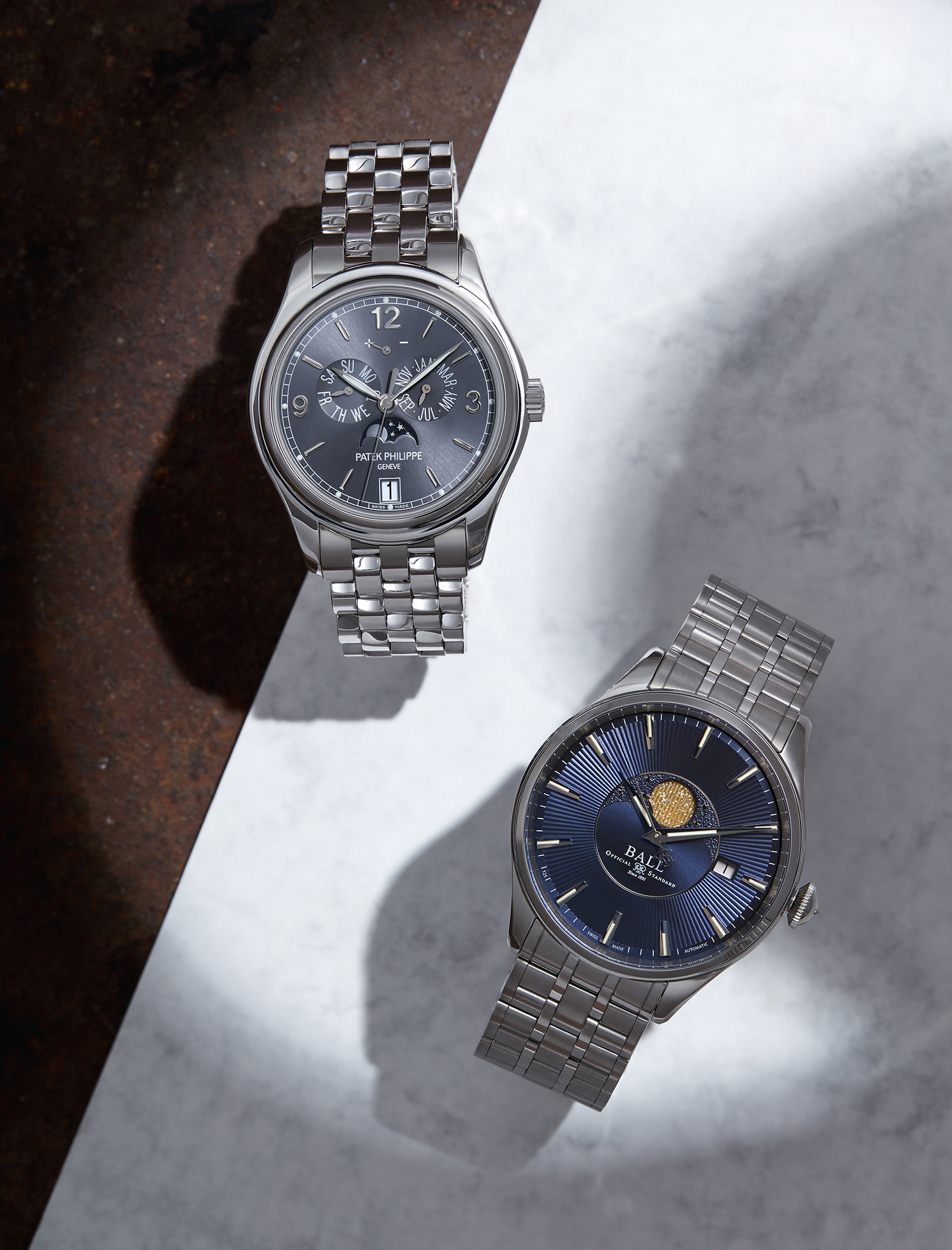 From left to right: Gentleman's self-winding Annual Calendar bracelet in white gold with slate grey sunburst dial, £50,610, PATEK PHILIPPE; Trainmaster Moonphase, £1,750, BALL