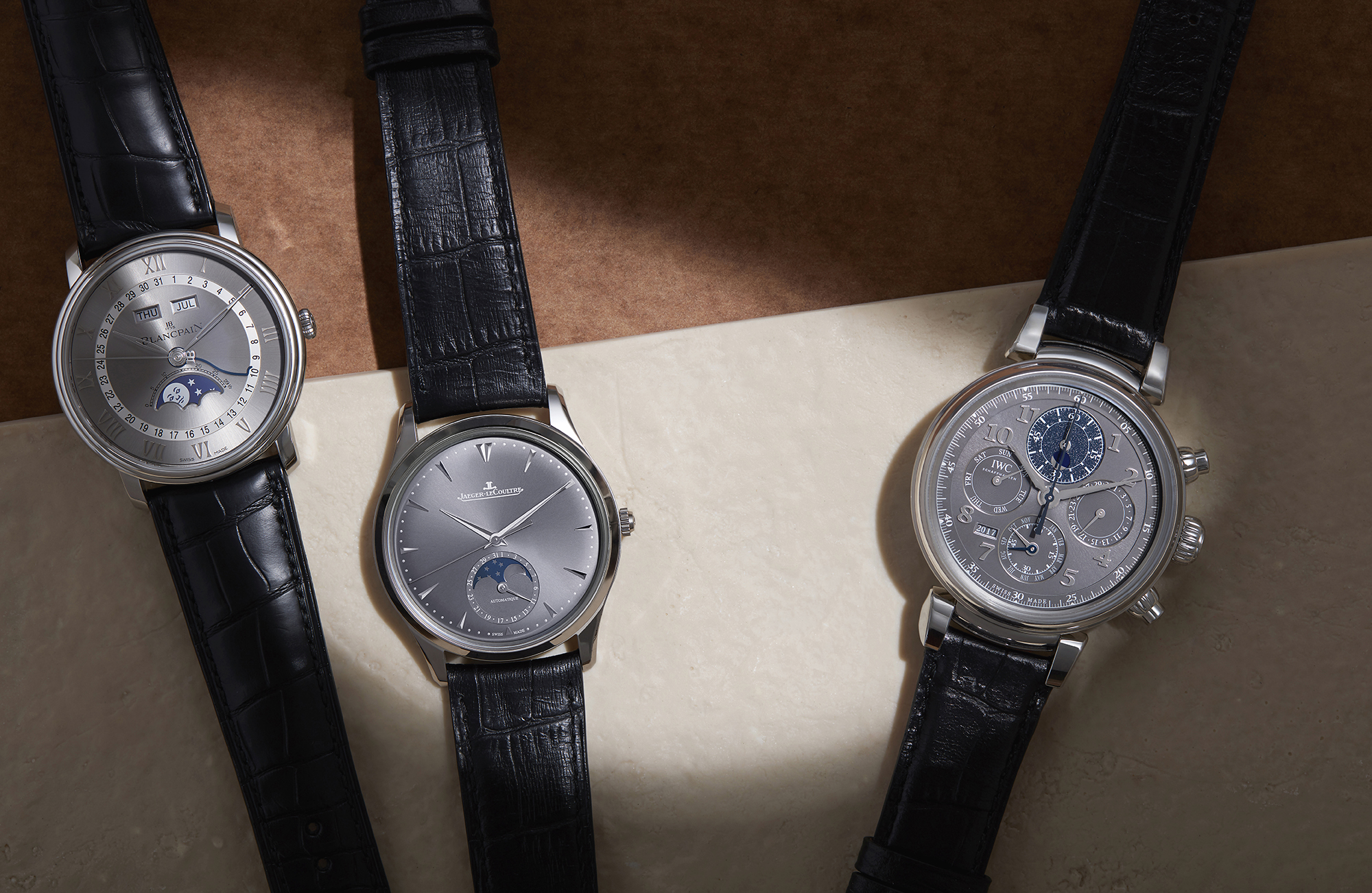 From left to right: Villeret Day Date Moonphase with grey dial, £10,930, BLANCPAIN; Master Ultra Thin Moon in white gold with selenite-grey dial on alligator leather strap, £16,300, JAEGER-LECOULTRE; Da Vinci Perpetual Calendar Chronograph, £26,250, IWC