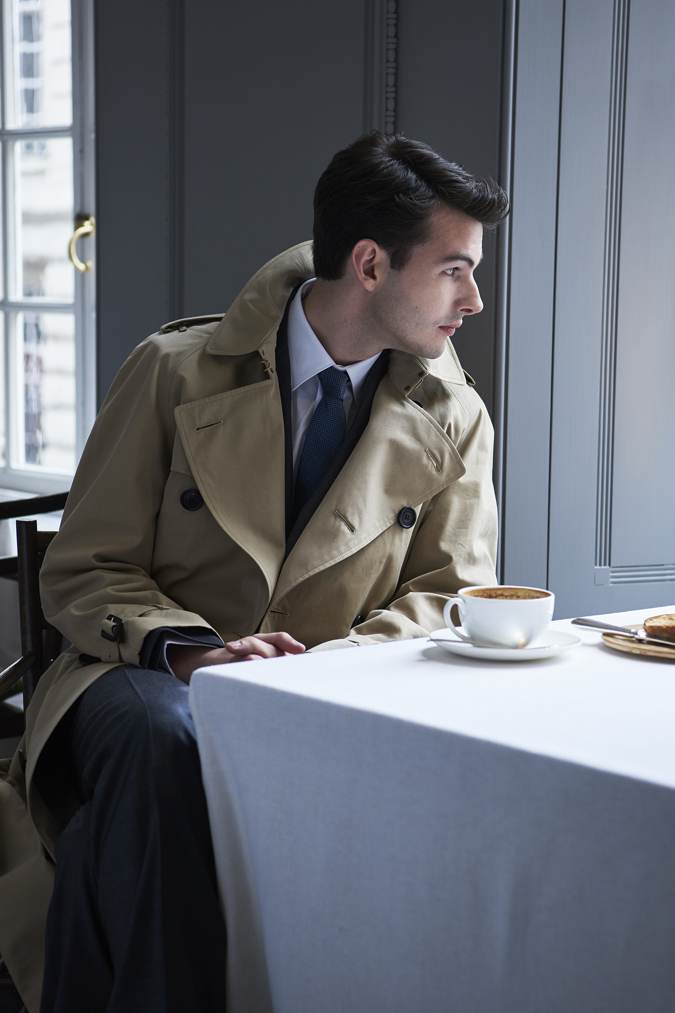Westminster extra long trench coat, £1,395; suit, £1,395; cotton shirt, £225; silk tie, £140