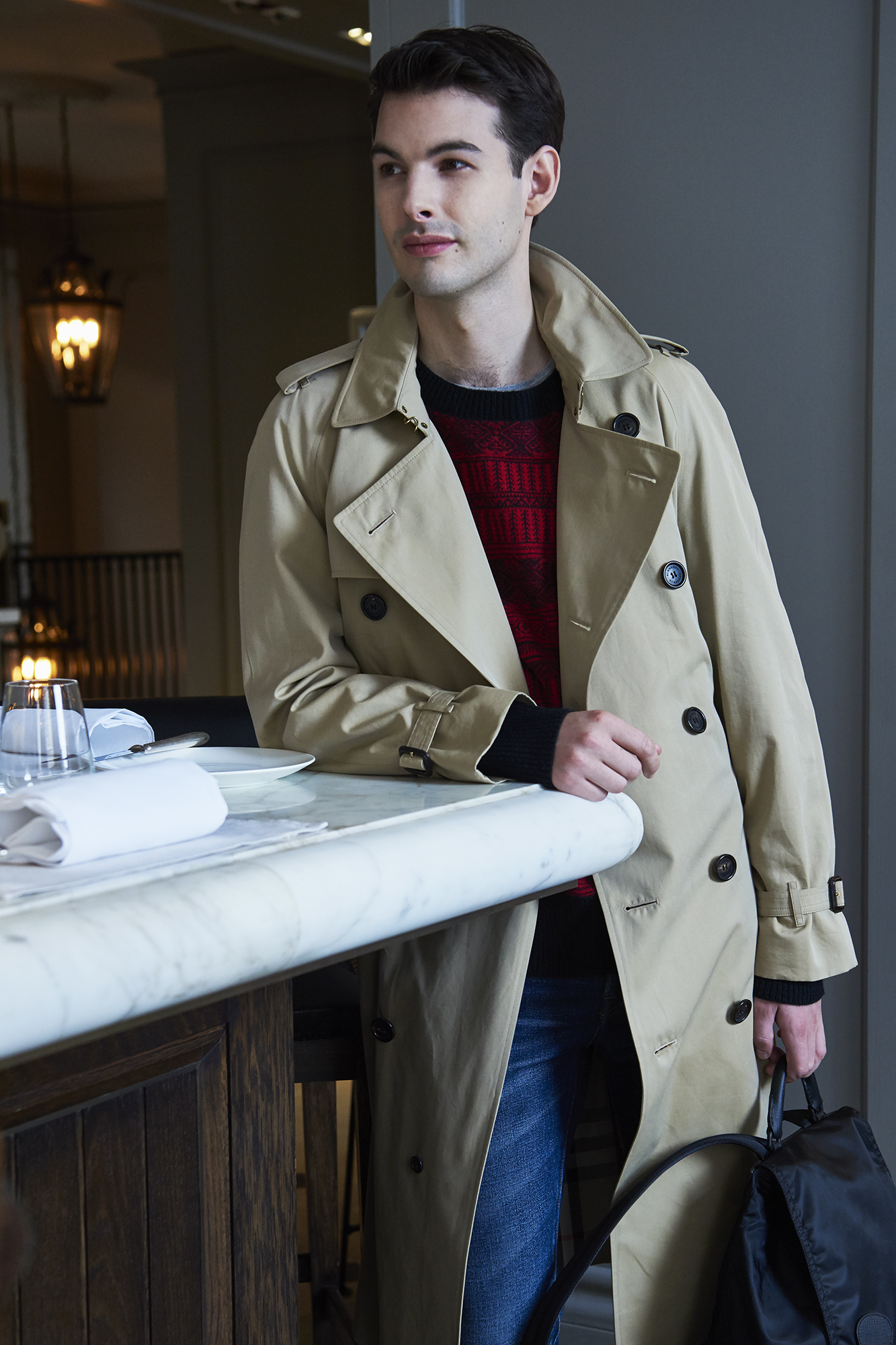 Trench, £1,395; wool and cashmere sweater, £425; cotton T-shirt, £85; straight-fit jeans, £250, rucksack, £995