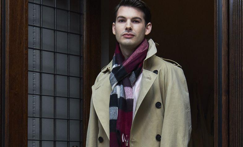 Trench, £1,395; cotton pique polo shirt, £145; cotton sweatpants, £195; cashmere scarf, £750