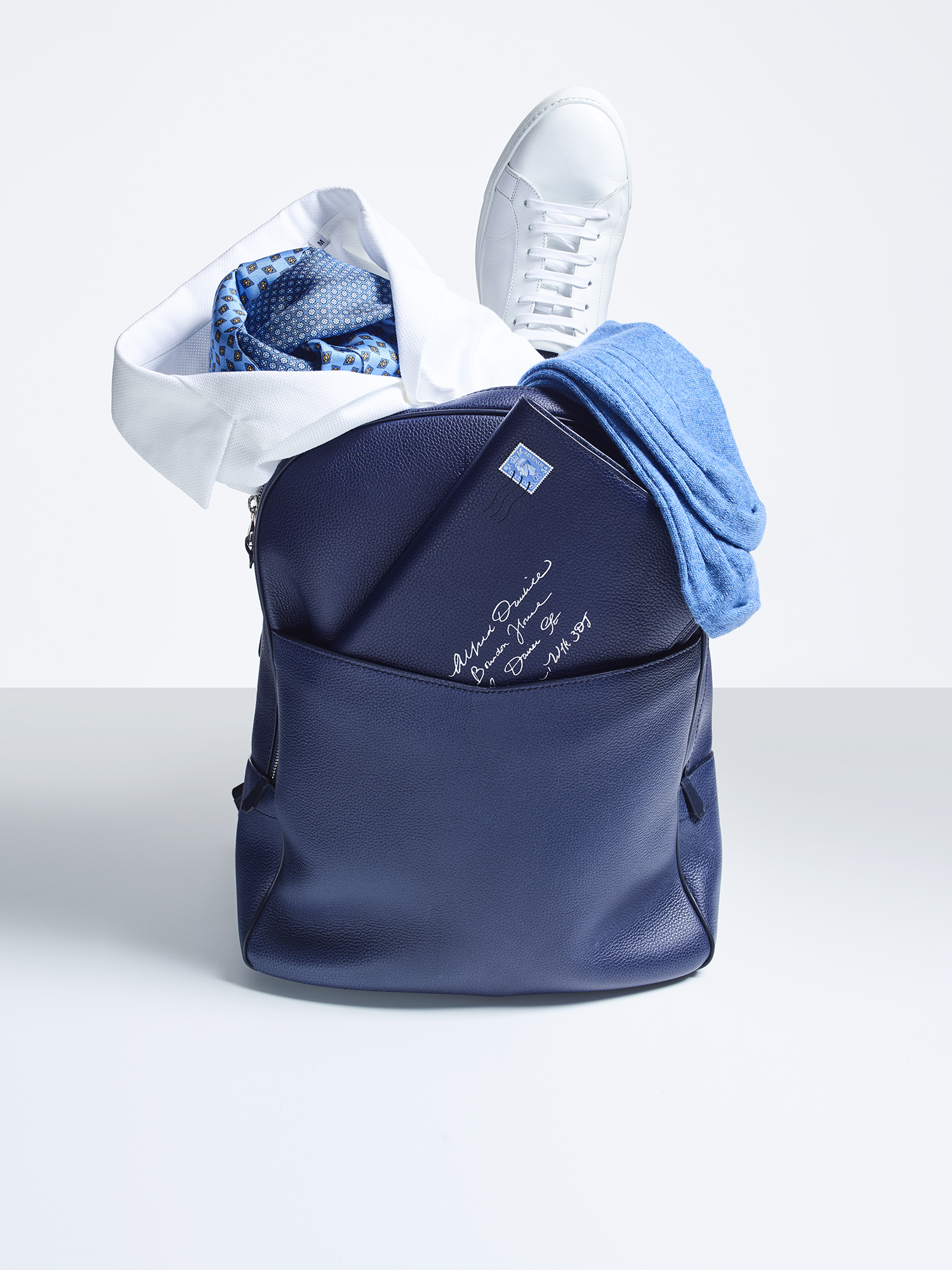Boston rucksack, £1,150; stripe socks, £50; leather sneakers, £360; silk polo shirt, £195; printed scarf, £195; notebook, £315