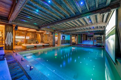 The spacious gold leaf-lined pool at the Marco Polo chalet in Val D'Isère