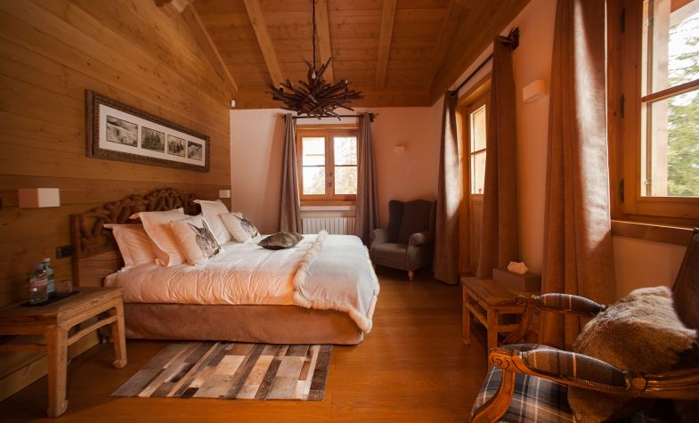 A cosy bedroom at Petite Marmotte in Courchevel