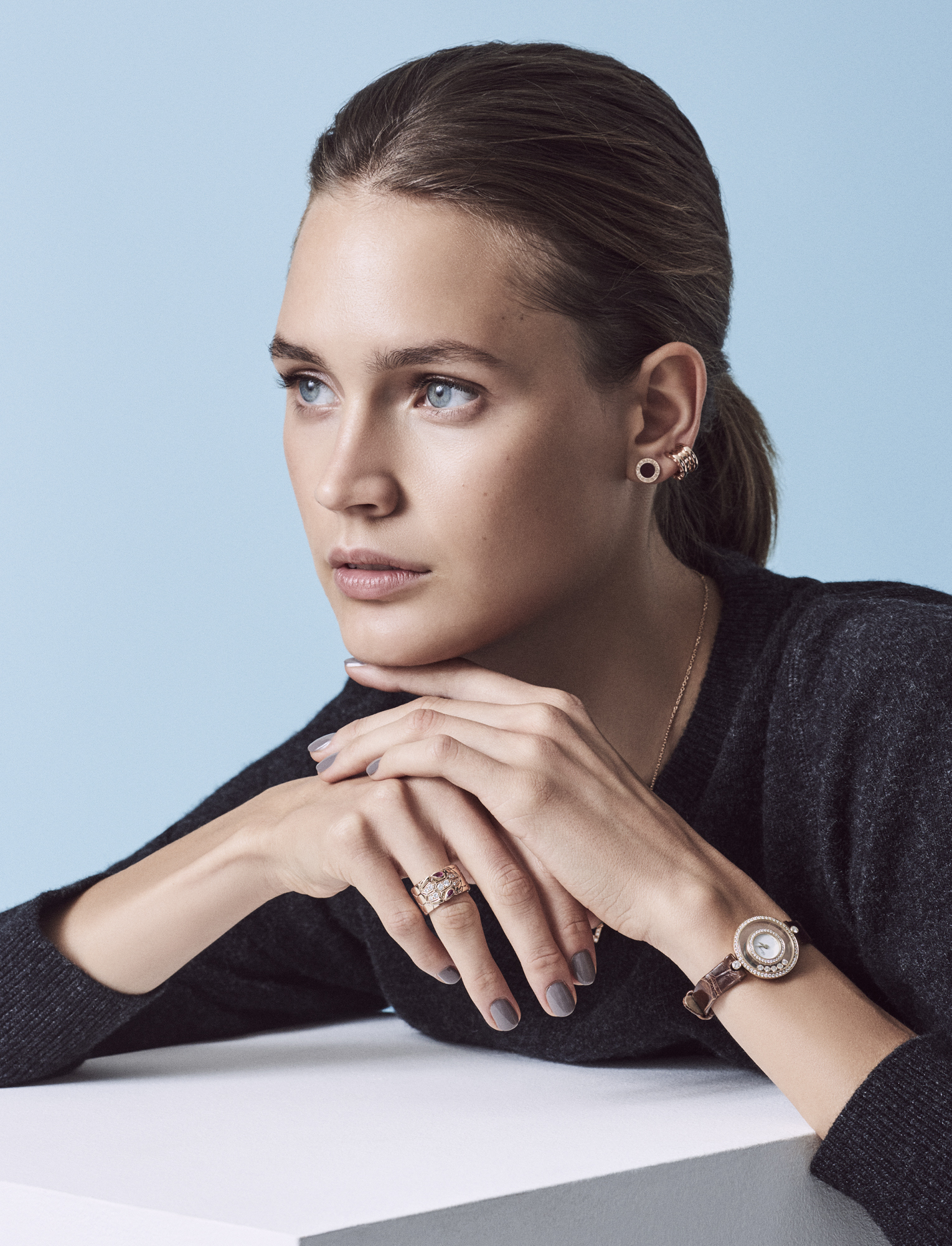 Lambswool sweatshirt, £180, SUNSPEL; ear cuff in 18ct rose gold, £1,180, single stud in 18ct rose gold, £690, and ring in 18ct rose gold, rubellite and pavé diamonds, £5,150, all BULGARI Happy Diamonds watch with dancing diamonds set in gold, on alligator strap, £11,800, CHOPARD