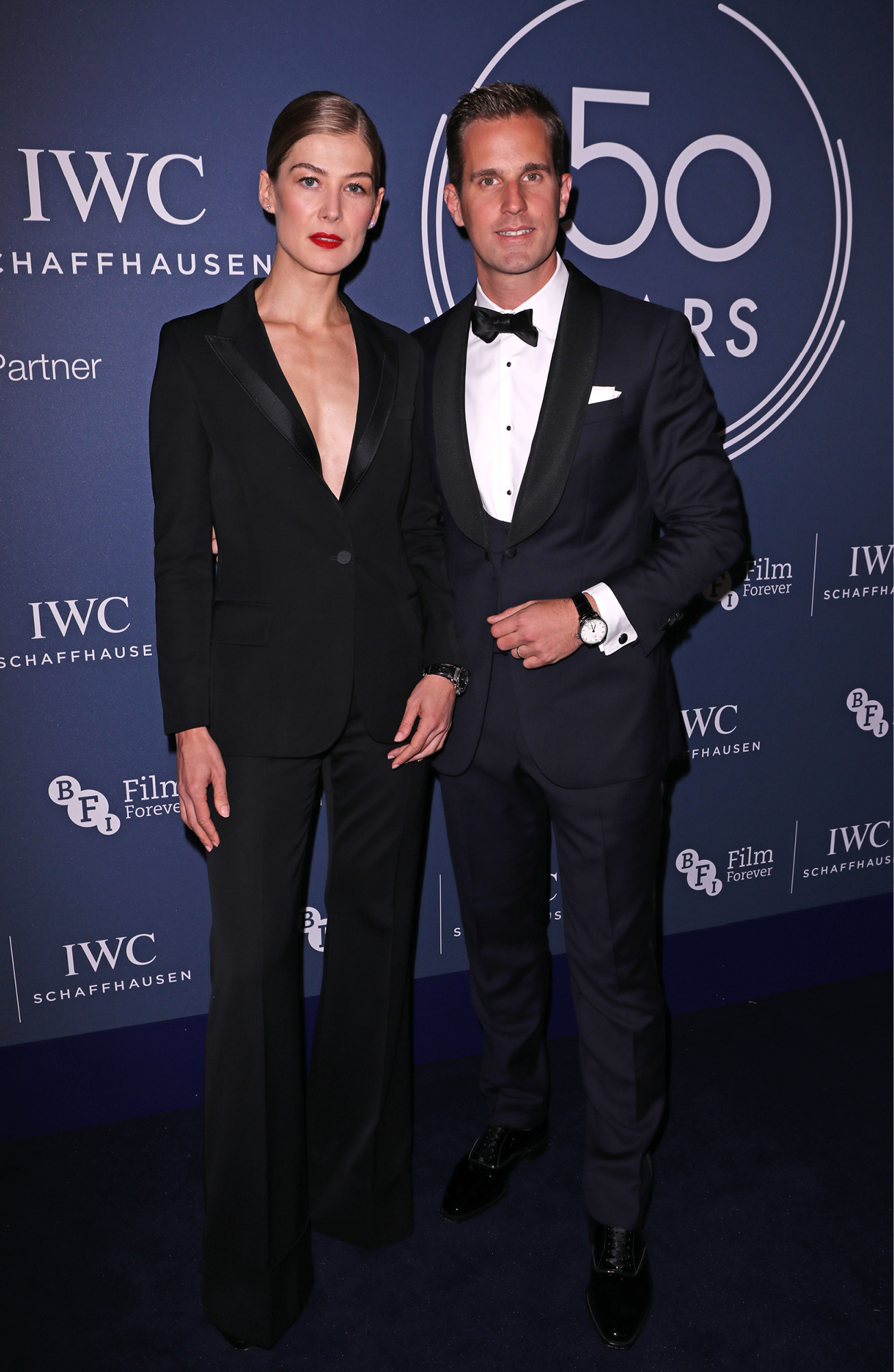 Rosamund Pike poses with IWC CEO Christoph Grainger-Herr