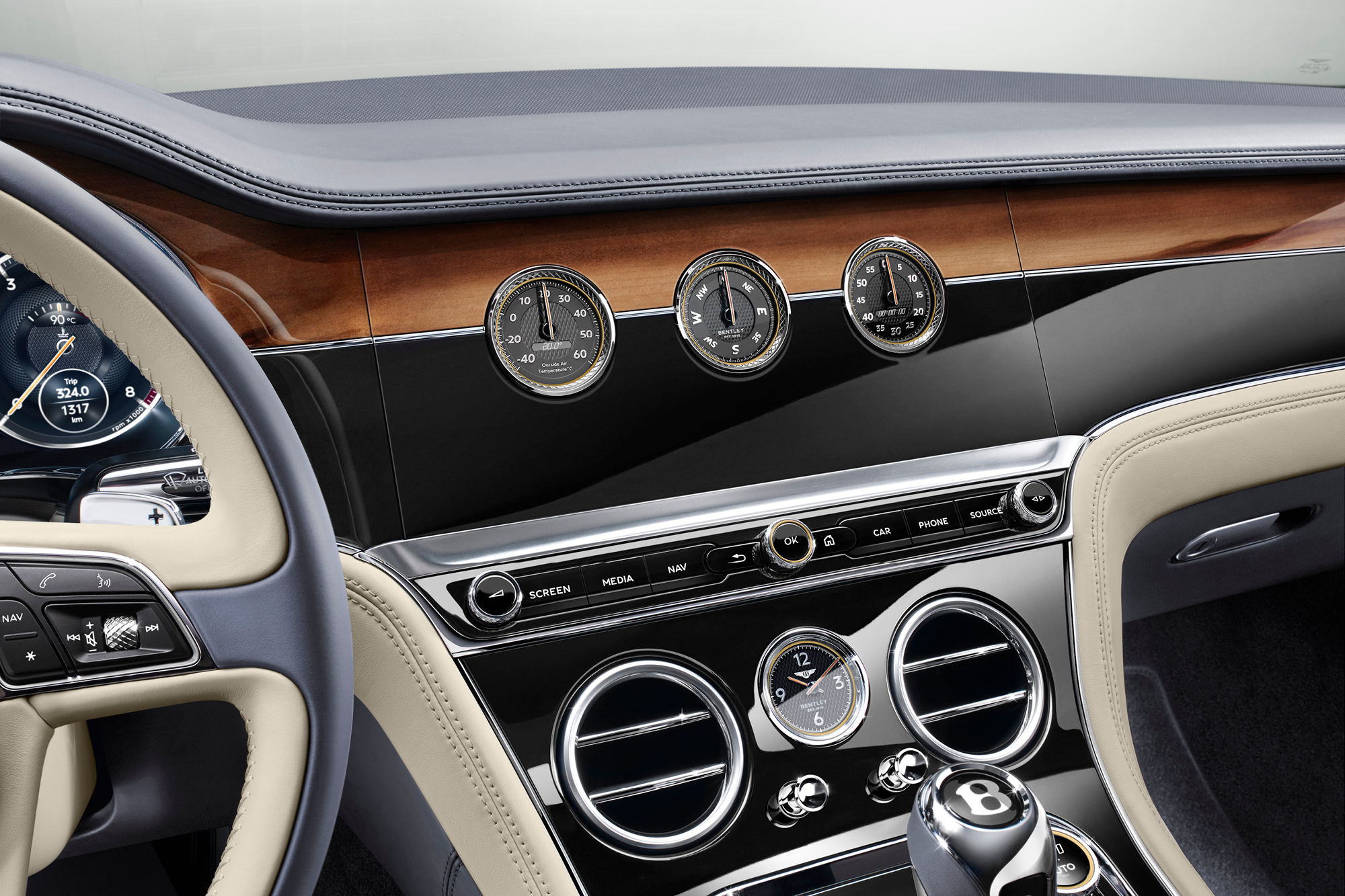 The Bentley Continental GT's rotating display gives the driver low-tech alternatives to the digital display