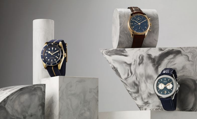 Bucherer Blue Editions - From left: Black Bay Bronze Blue 43mm, £2,860, TUDOR; Portugieser 42mm rose gold round dial automatic, £17,950, IWC; Polo S 42mm stainless steel cushion dial automatic, £11,400, PIAGET