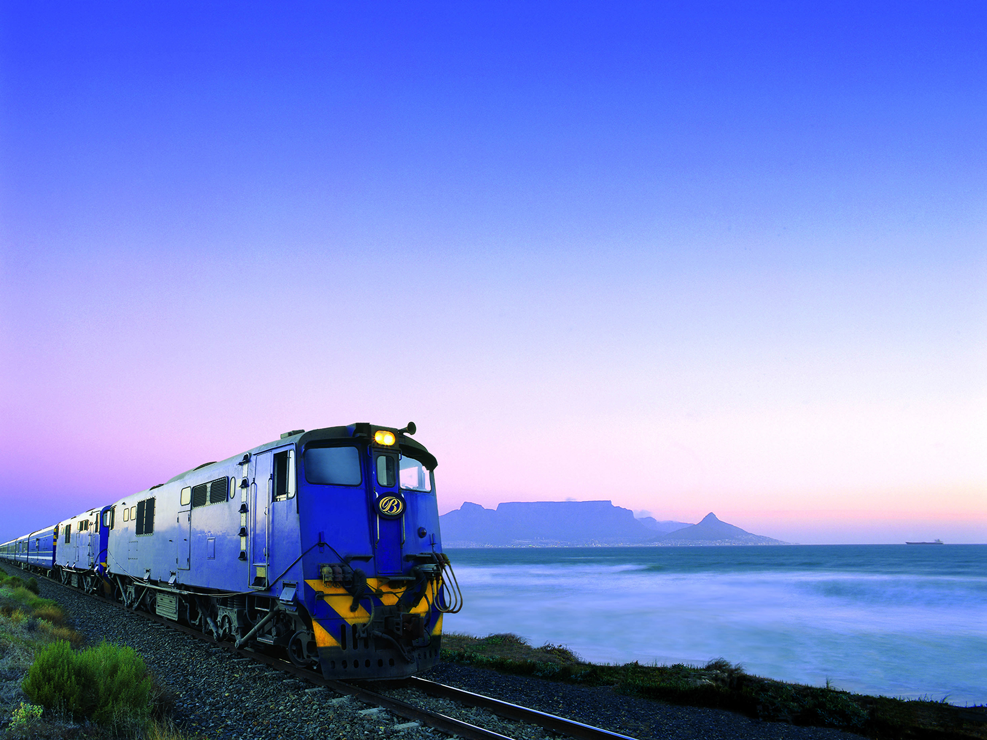 Blue Train passes Table Mountain at sunset