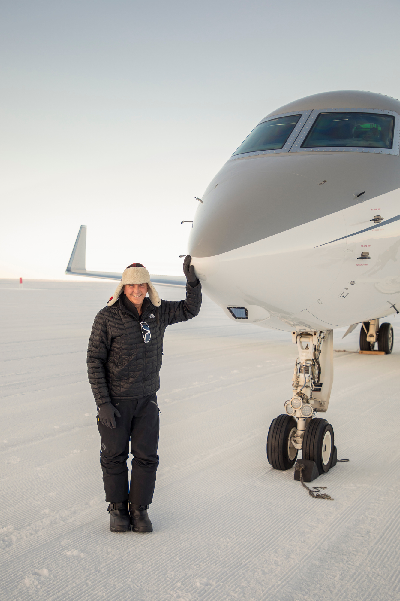 Geoffrey Kent with the aircraft that transported his expedition group to Antartica