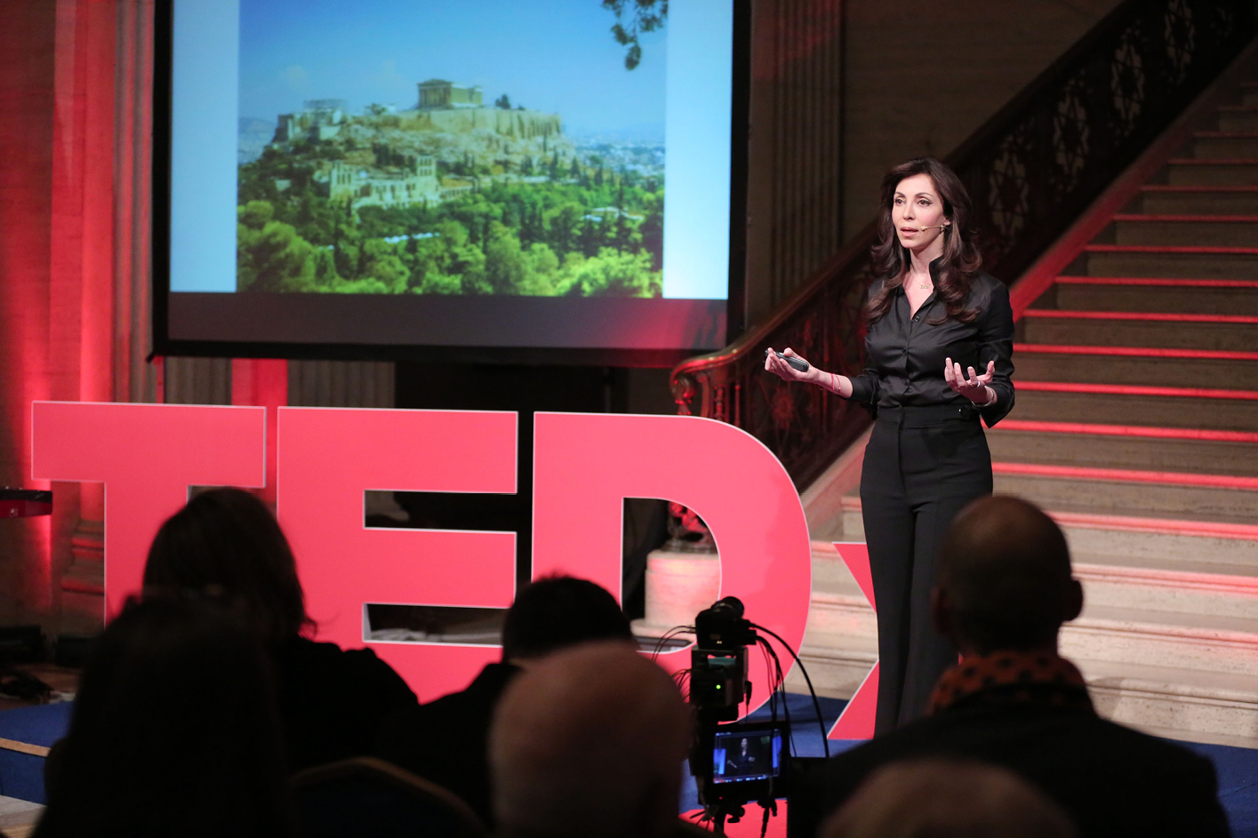Elizabeth Filippouli giving a TEDx talk about being a global thinker