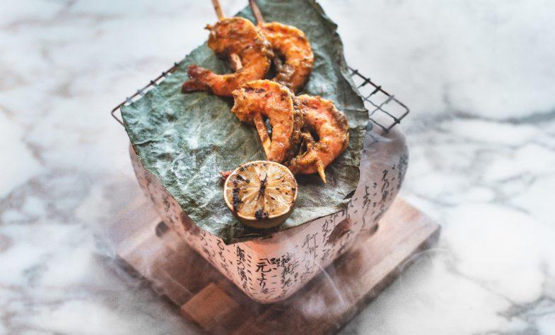 Sake-flamed black garlic king prawns with chilli and cumin at Bloomsbury Street Kitchen. Photograph: Em Azodi
