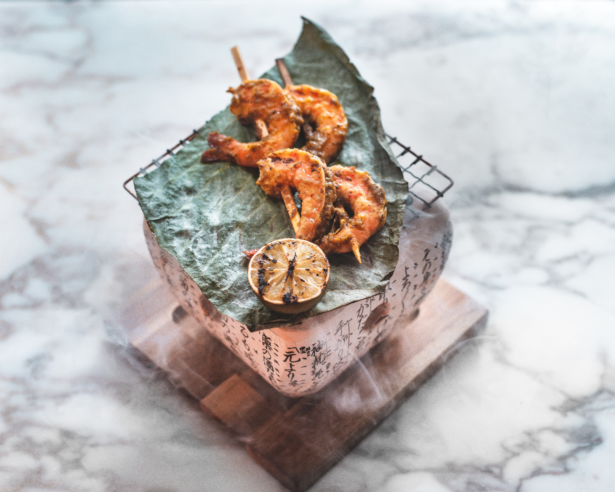 Sake-flamed black garlic king prawns with chilli and cumin at Bloomsbury Street Kitchen. Photograph: Em Azodi