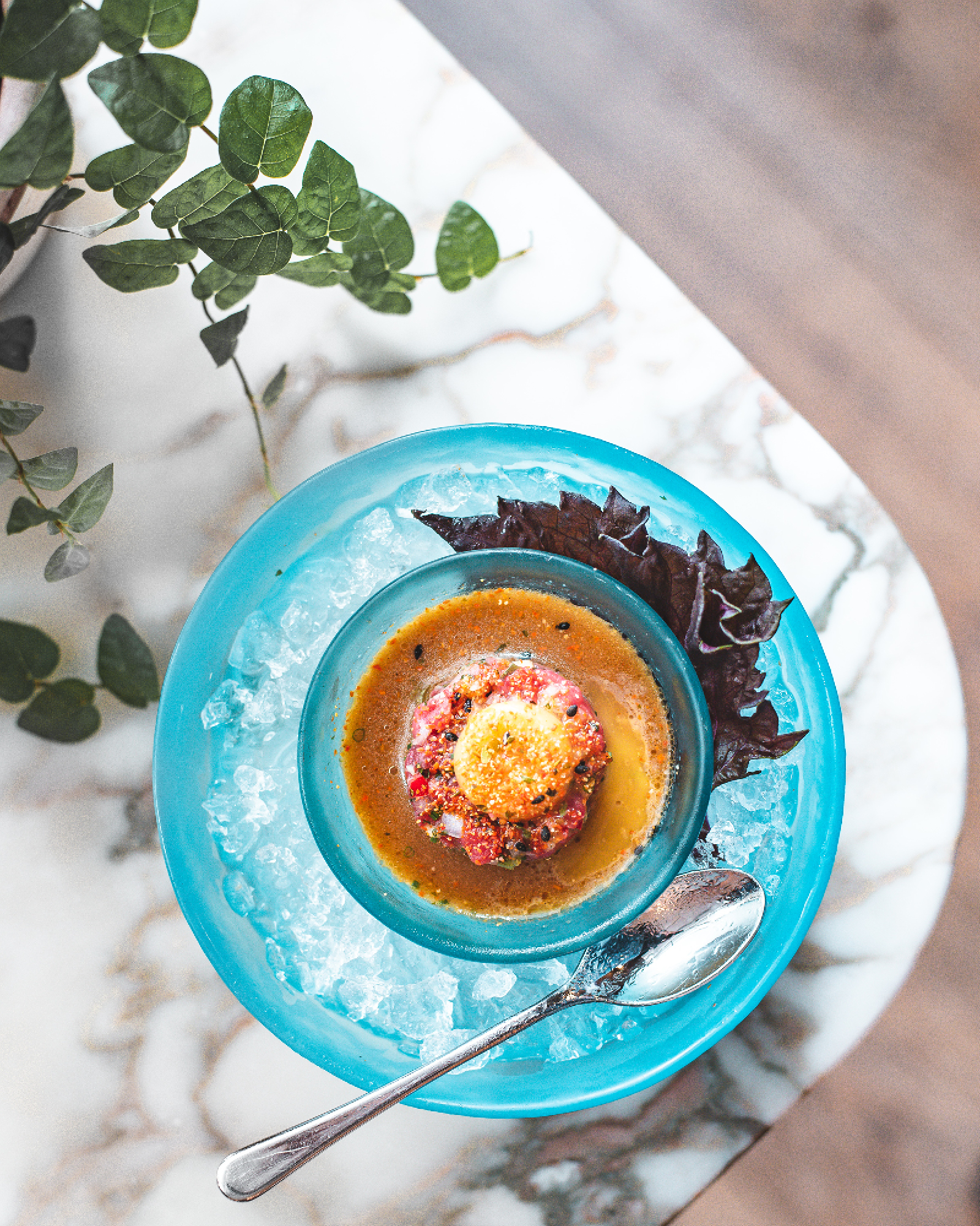 Beef tartare with egg yolk and spicy schichimi soy. Photograph: Em Azodi