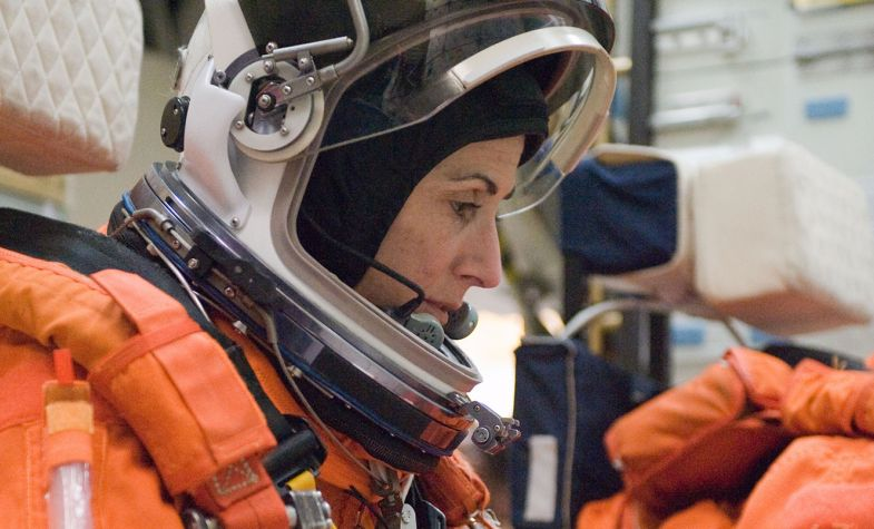 NASA astronaut Nicole Stott, STS-133 mission specialist, participates in a post insertion/de-orbit training session on the mid-deck of the crew compartment trainer in the Space Vehicle Mockup Facility at NASA's Johnson Space Center, 23 March 2010. Stott is wearing a training version of her shuttle launch and entry suit. Credit: NASA