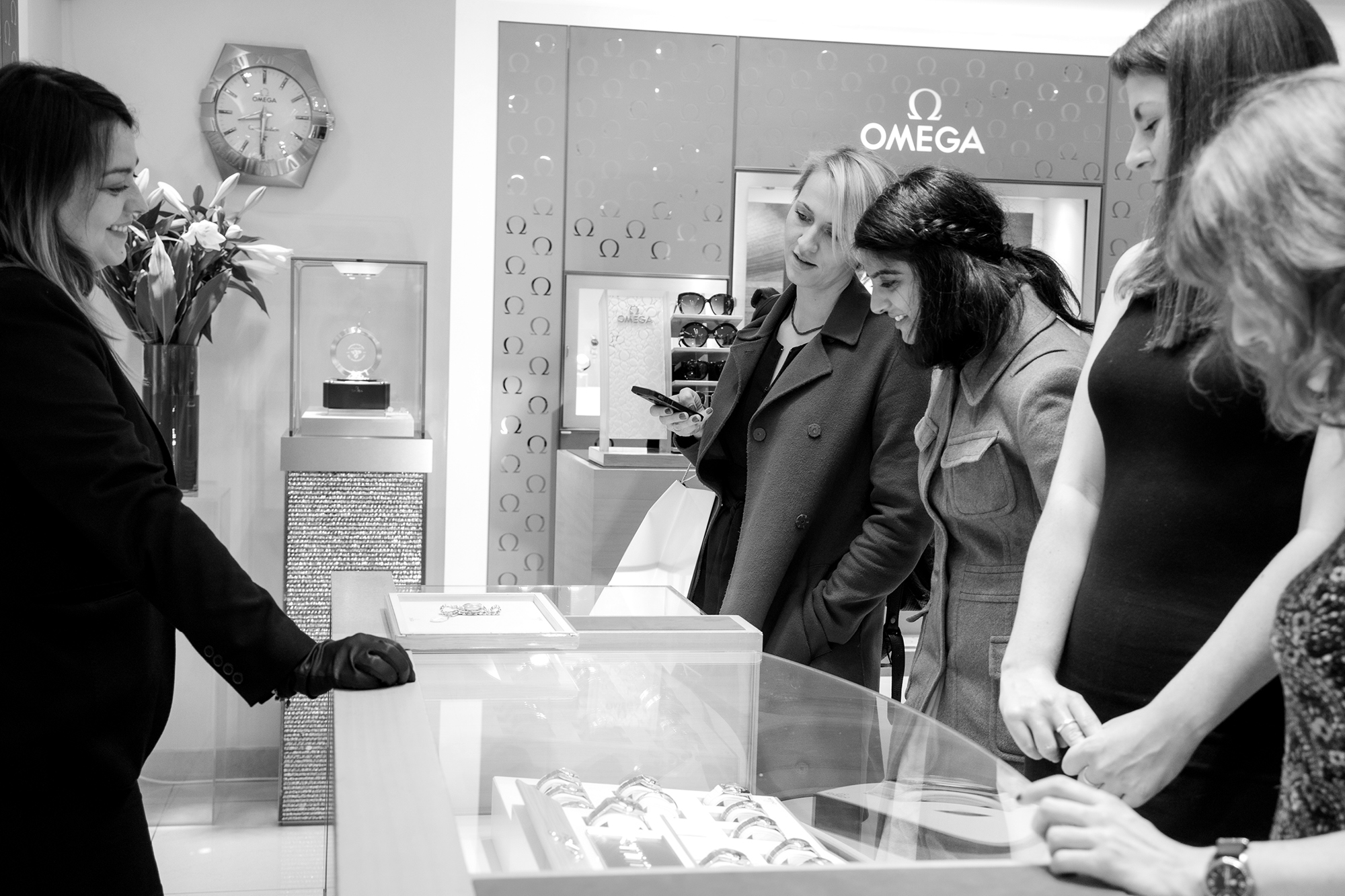 Guests talk to the watch experts at The Royal Exchange's Omega boutique