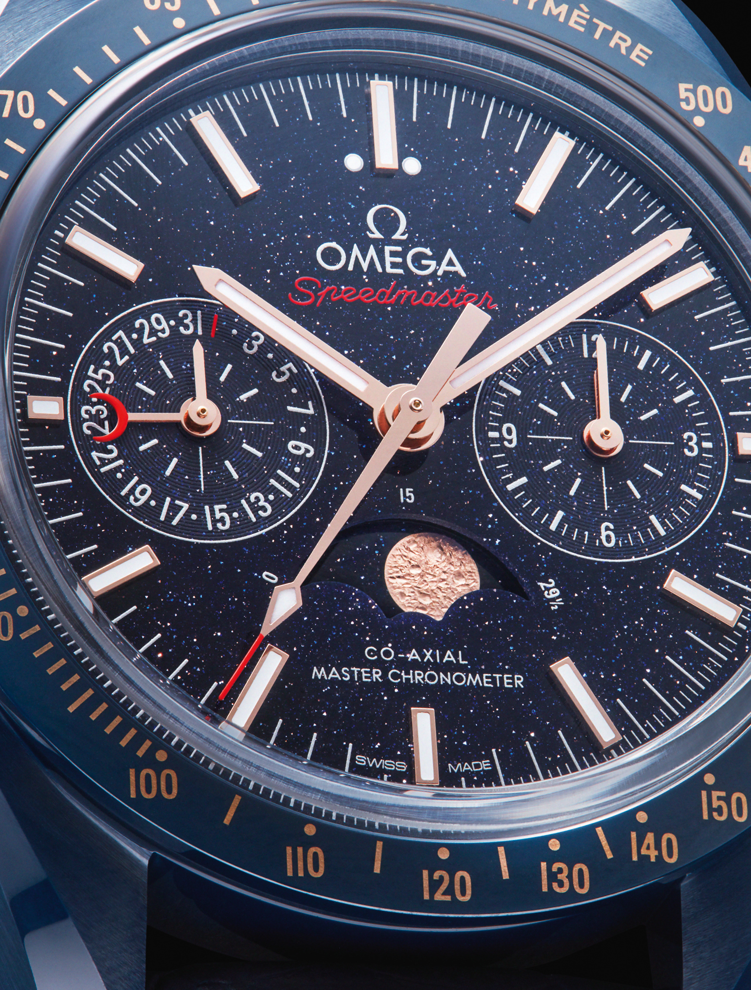mega's 44.25mm Speedmaster Moonwatch 'Blue Side of the Moon' is a Master Chronometer Moonphase Chronograph featuring a blue aventurine glass dial and blue ceramic case complemented by a blue ceramic bezel ring. £11,040, OMEGA
