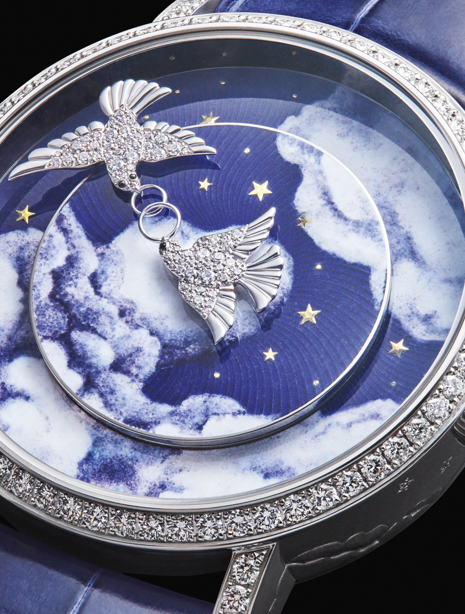 The dial of Chaumet's Complication Créative Colombes features two diamond doves in place of hands, against an enamel blue sky. Every hour, the birds meet and join their rings together to form an 8, representing eternity. £POA, CHAUMET