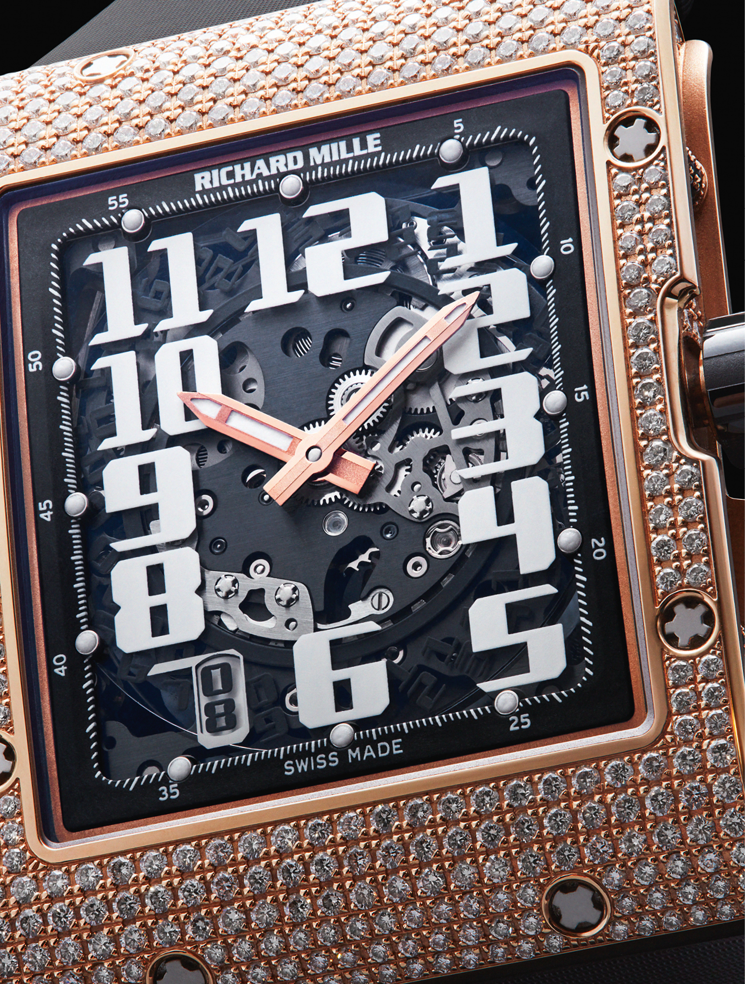 The Richard Mille RM016 Automatic Winding Extra Flat 18ct Red Gold model with diamonds allows the rewinding of the mainspring to be adapted most effectively to the user's activity levels. £171,000, RICHARD MILLE
