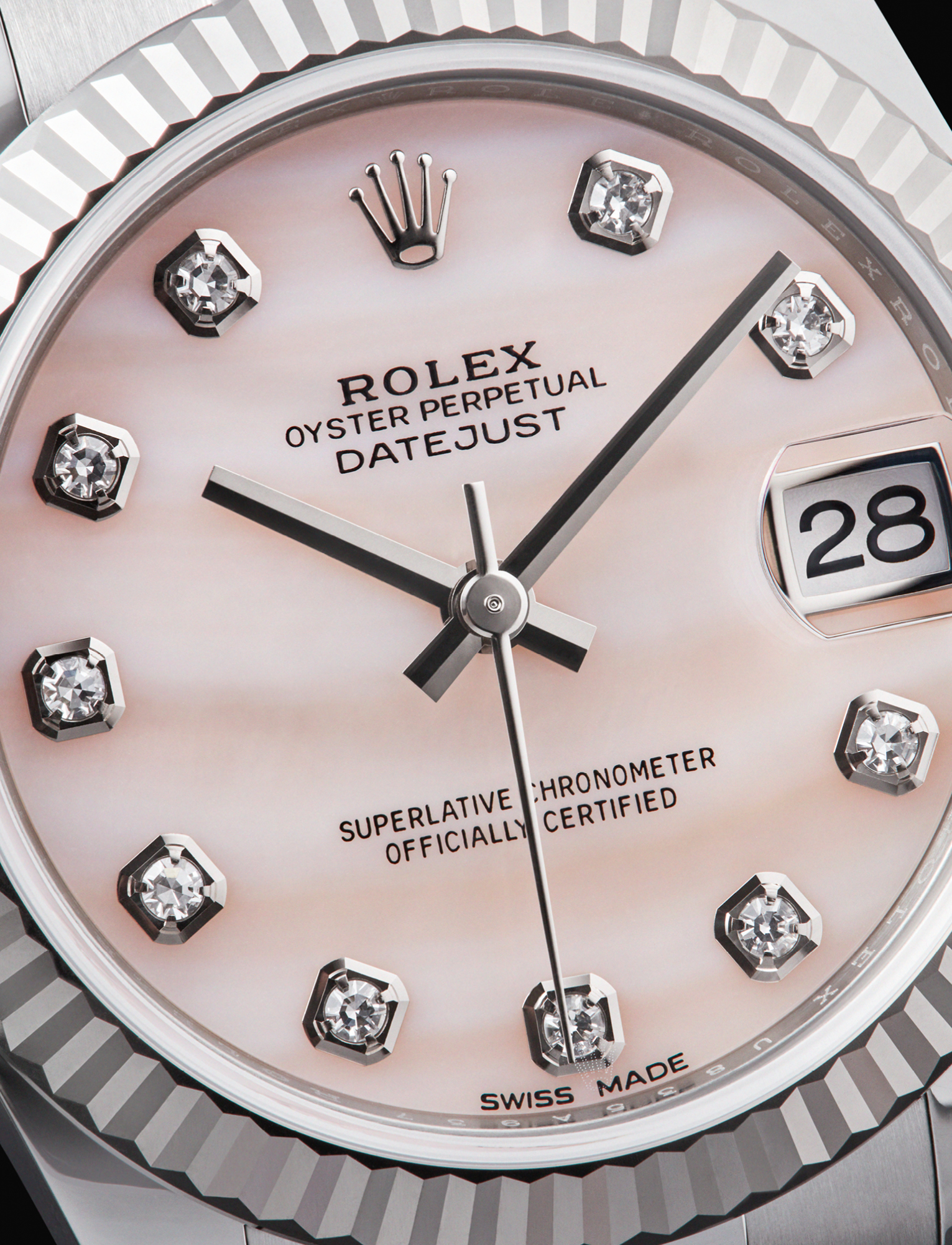 The iconic Rolex Datejust 31 is characterised by its oyster steel and white gold case and bracelet, and its pink mother-of- pearl dial featuring diamonds markers. It is powered by a calibre 2235 self-winding mechanical movement. £9,150,ROLEX