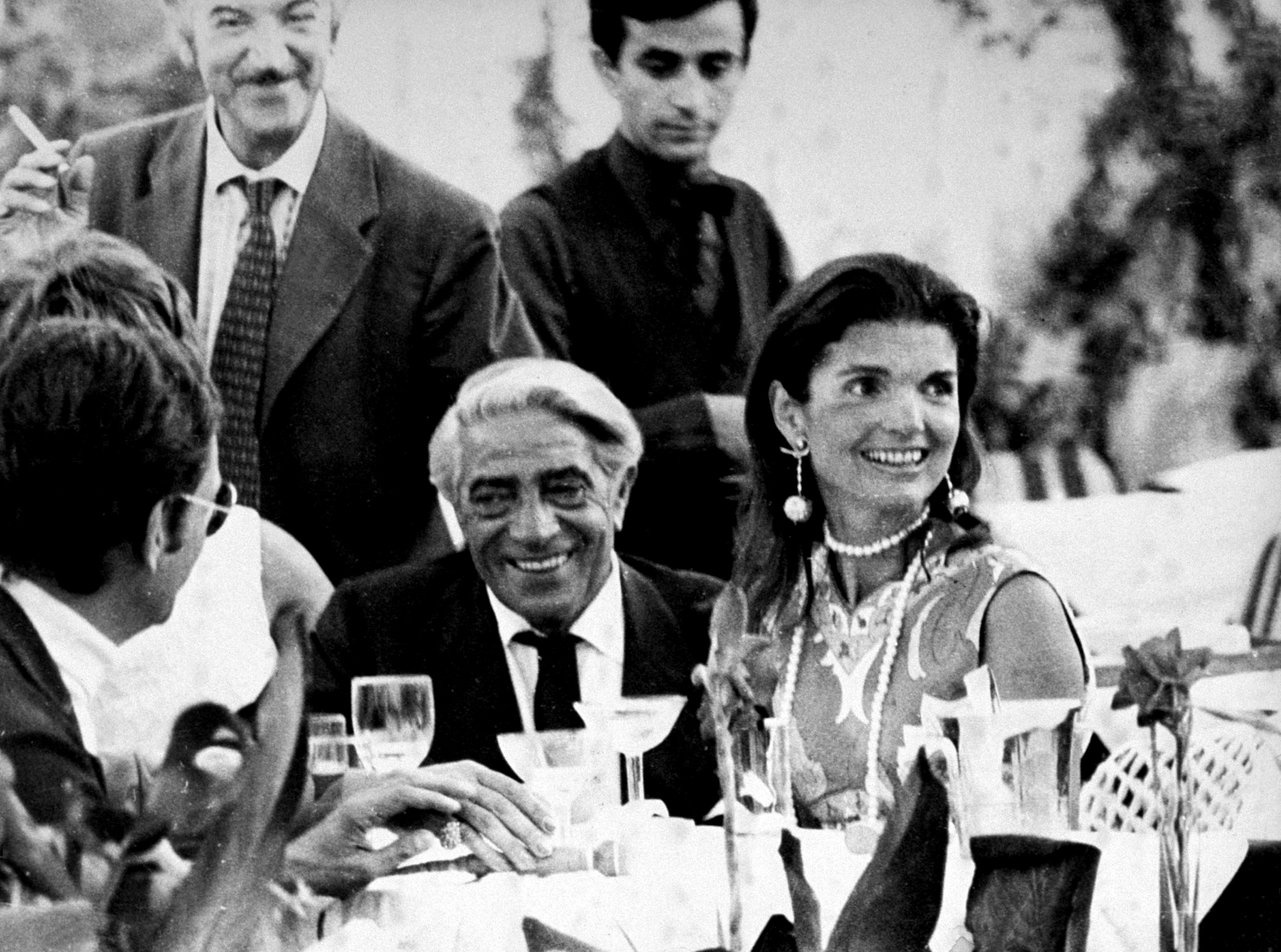Aristotle Onassis with wife Jackie, who is wearing a pair of Lalaounis Apollo earrings, designed to commemorate the moon landing in 1969.