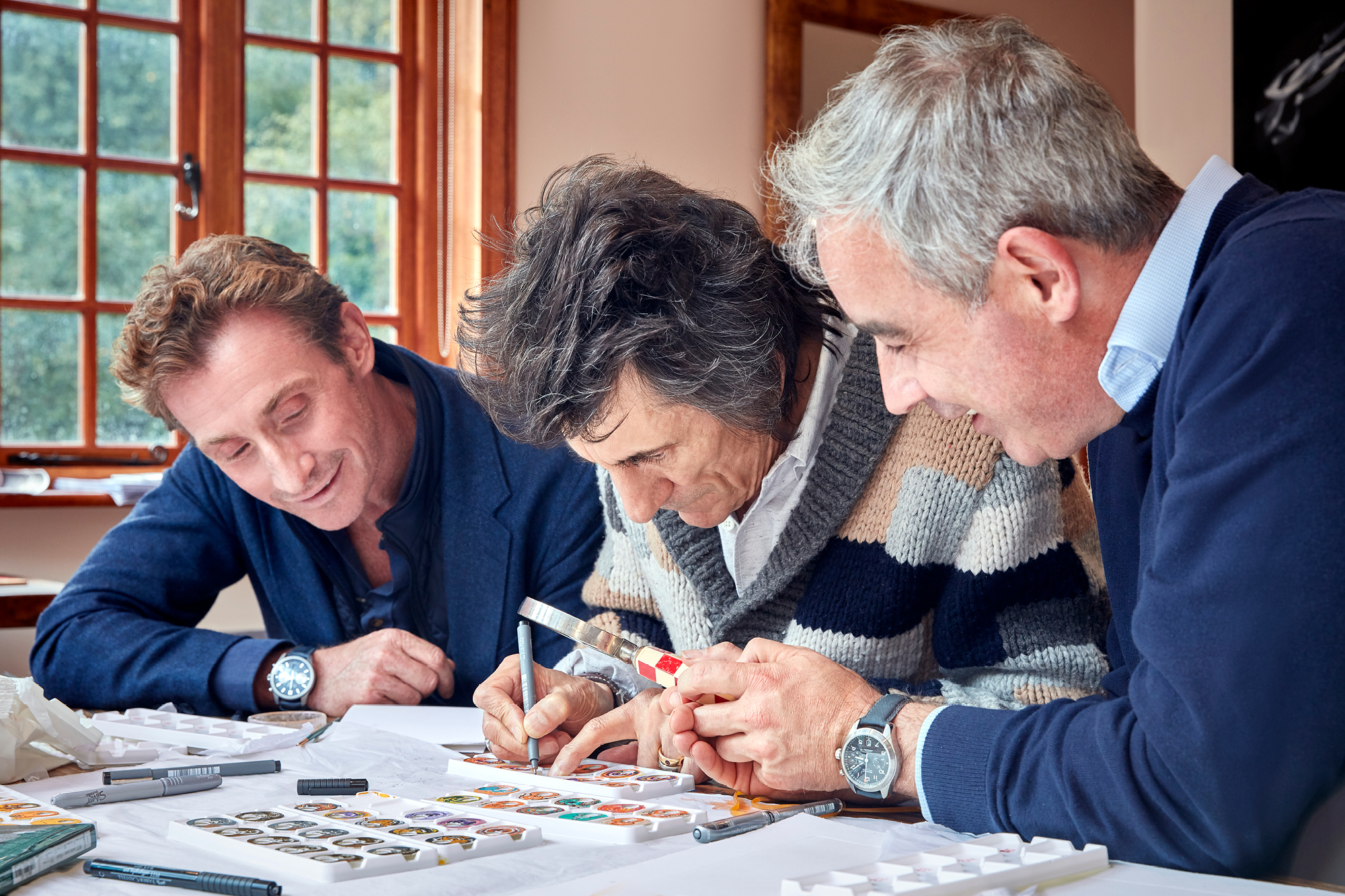 Ronnie Wood with Bremont Founders Nick and Giles English