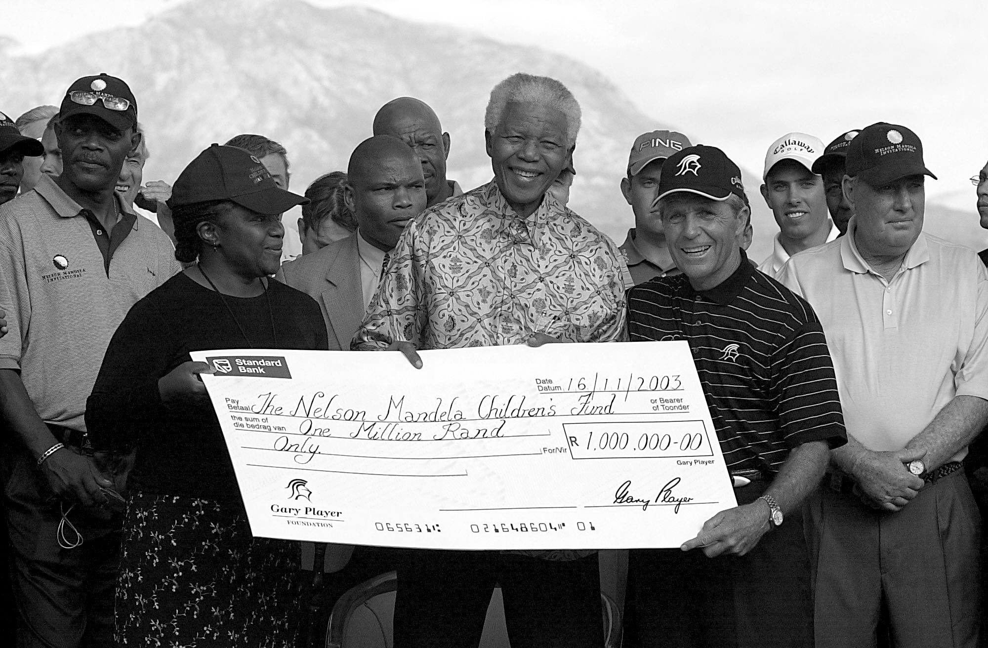 Gary Player presenting a donation to Nelson Mandela
