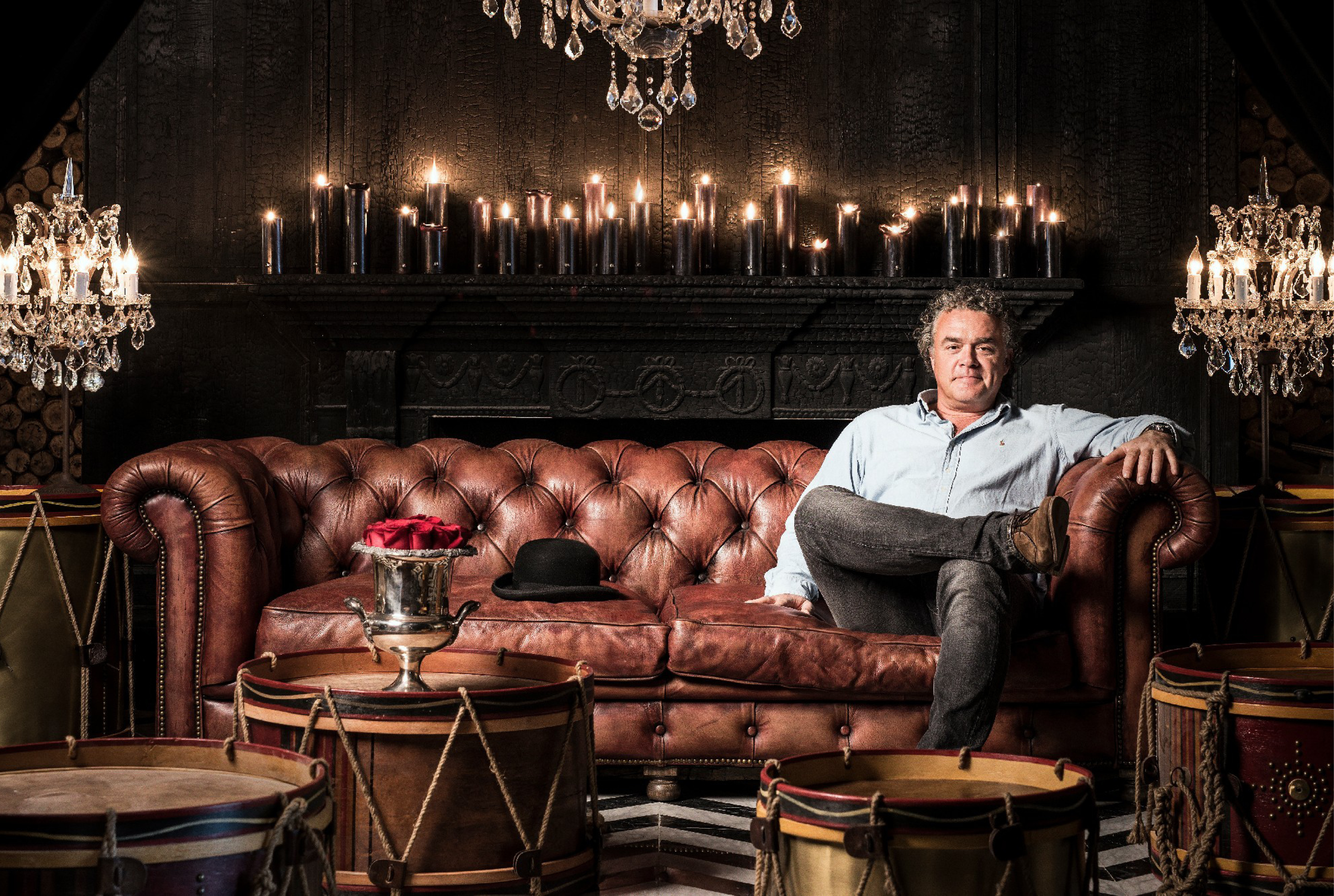 Interior designer Timothy Oulton relaxes on a Chesterfield