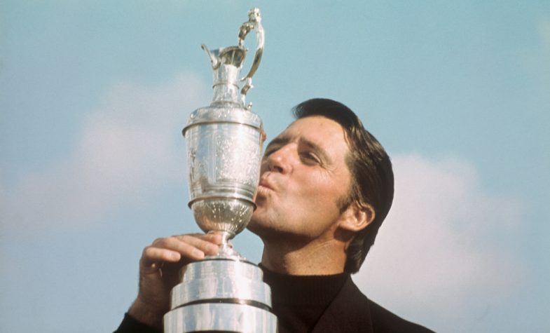 Player kissing his British Open Championship trophy in July 1974