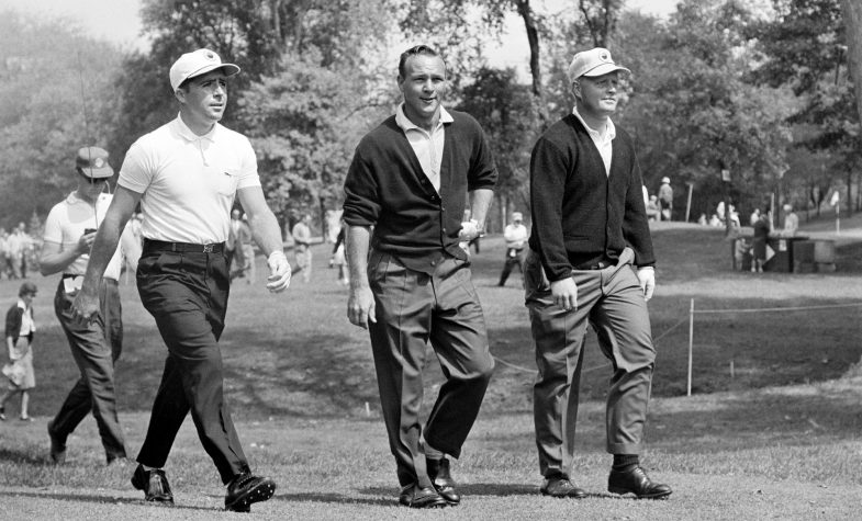 Player on the fairway with Arnold palmer and Jack Nicklaus.