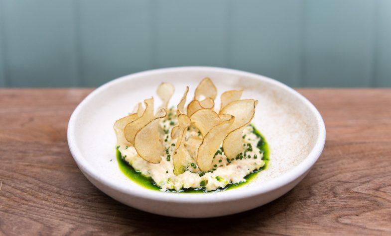 Smoked fish bacalhau, potato crisp, chives at The Laundry
