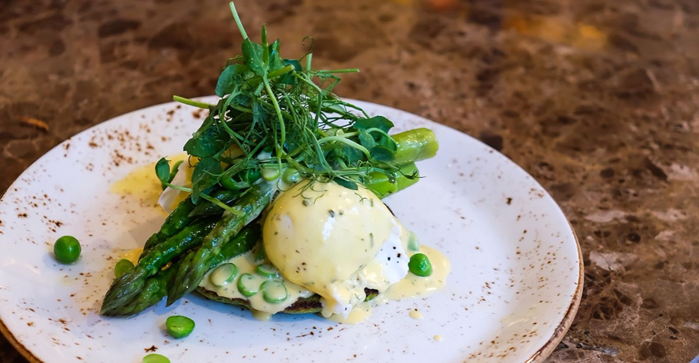 Tom Aikens pea pancakes with poached eggs and herb sabayon