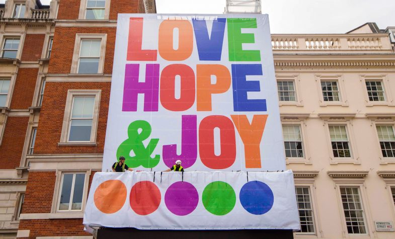 Anthony Burrill's Love, Hope & Joy on display in Covent Garden piazza