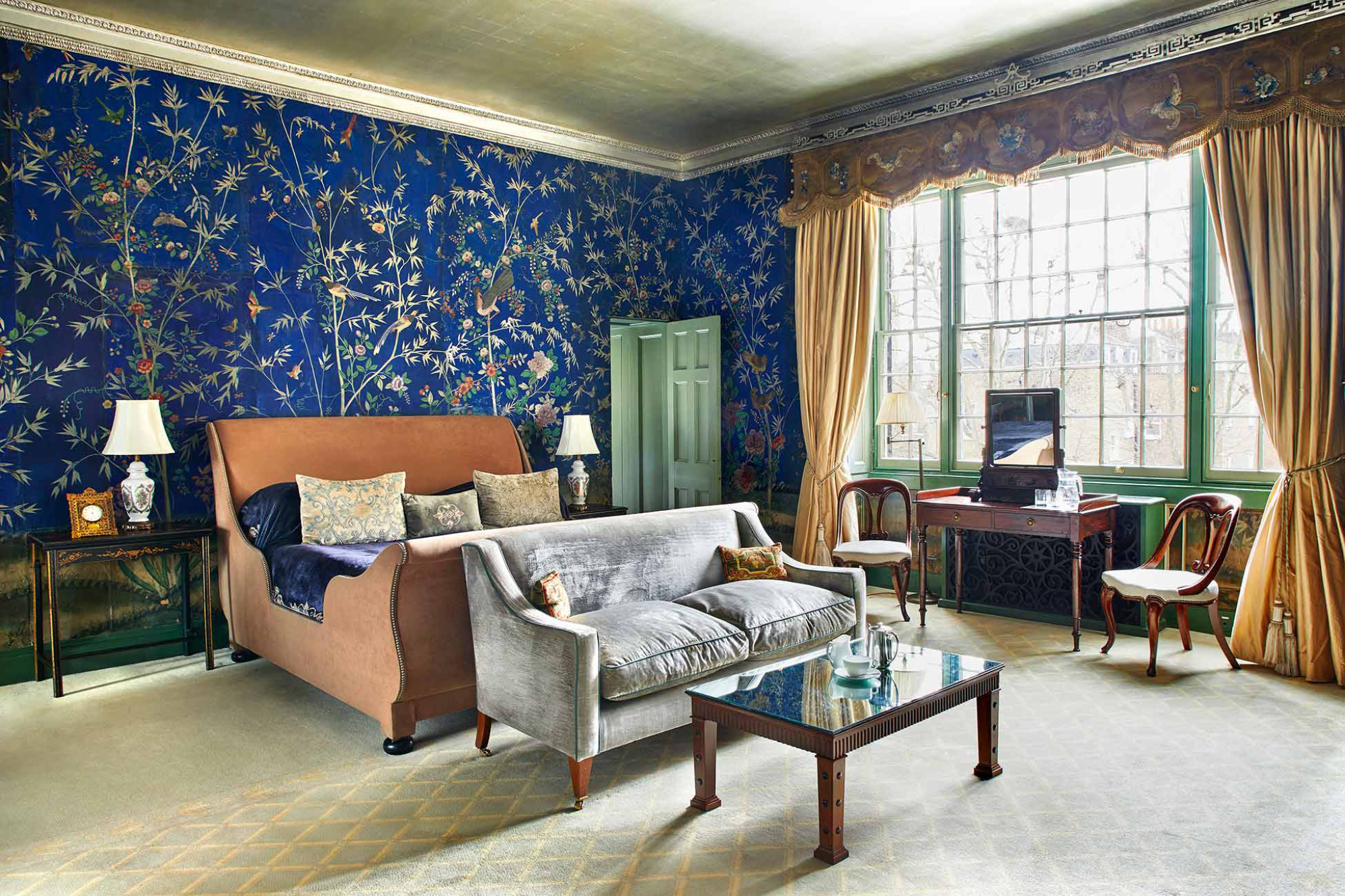 The ornate hand-painting wallpaper of the Patricia Portman room makes it one of the most covetable bedrooms for a Home House staycation