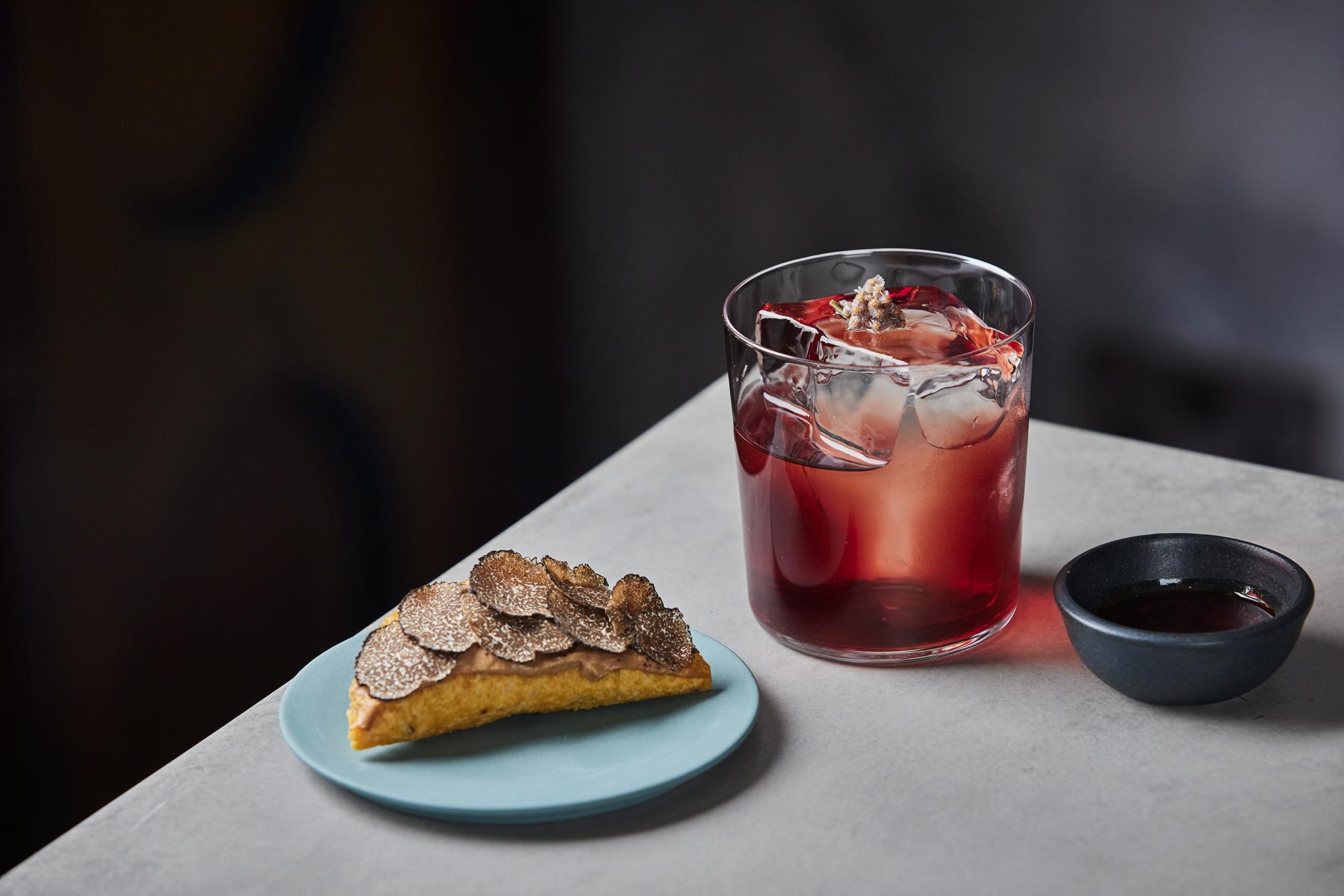 Sloe Grape Mezcal Negroni made with homemade sloe mezcal, Campari, Cocchi Torino sweet vermouth, Bava Uvantica Malvasia, with a pickled yarrow flower garnish. Photograph: Charlie McKay